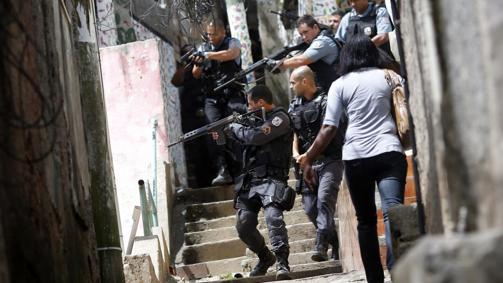 favela crime youth To combat favela crime, the authorities established a special military police pacifying unit the locals are now held hostage by the continuing war between gangsters and government forces, with bullets flying through family homes and children frequently caught in the crossfire.